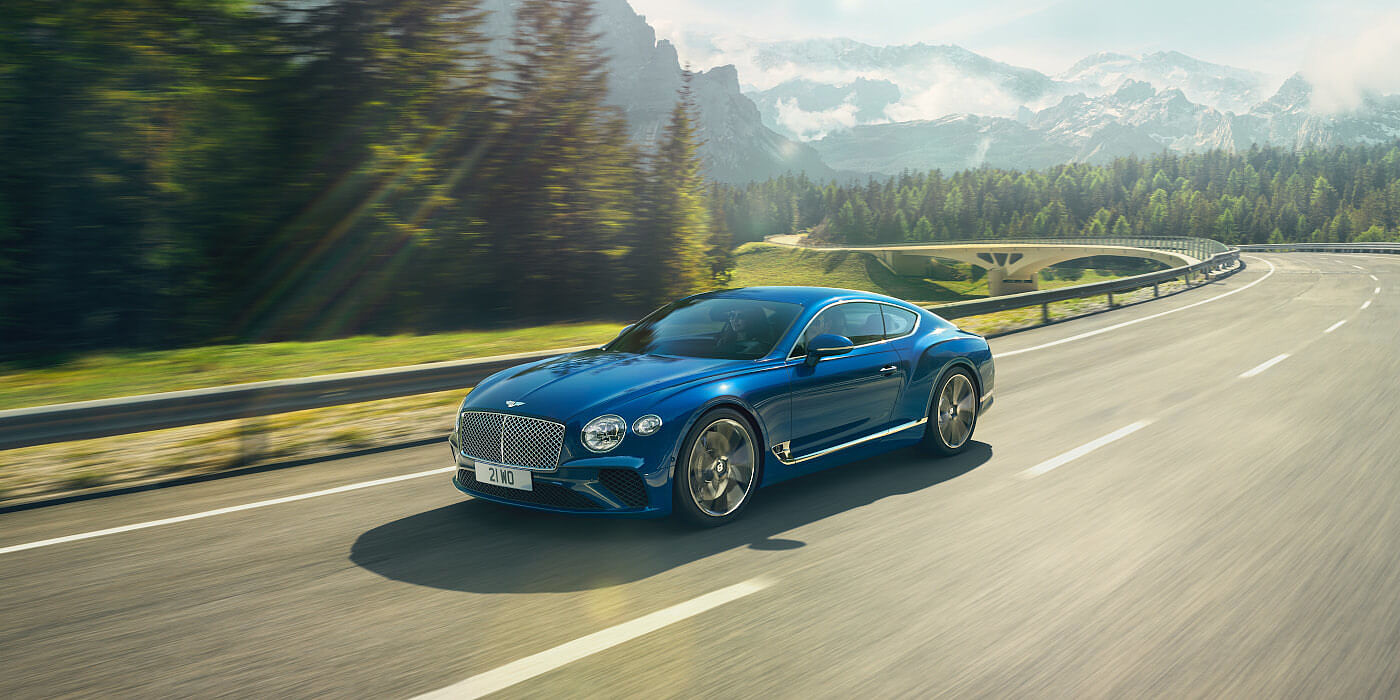 BENTLEY-CONTINENTAL-GT-IN-SEQUIN-BLUE-PAINT-ON-MOUNTAIN-ROAD